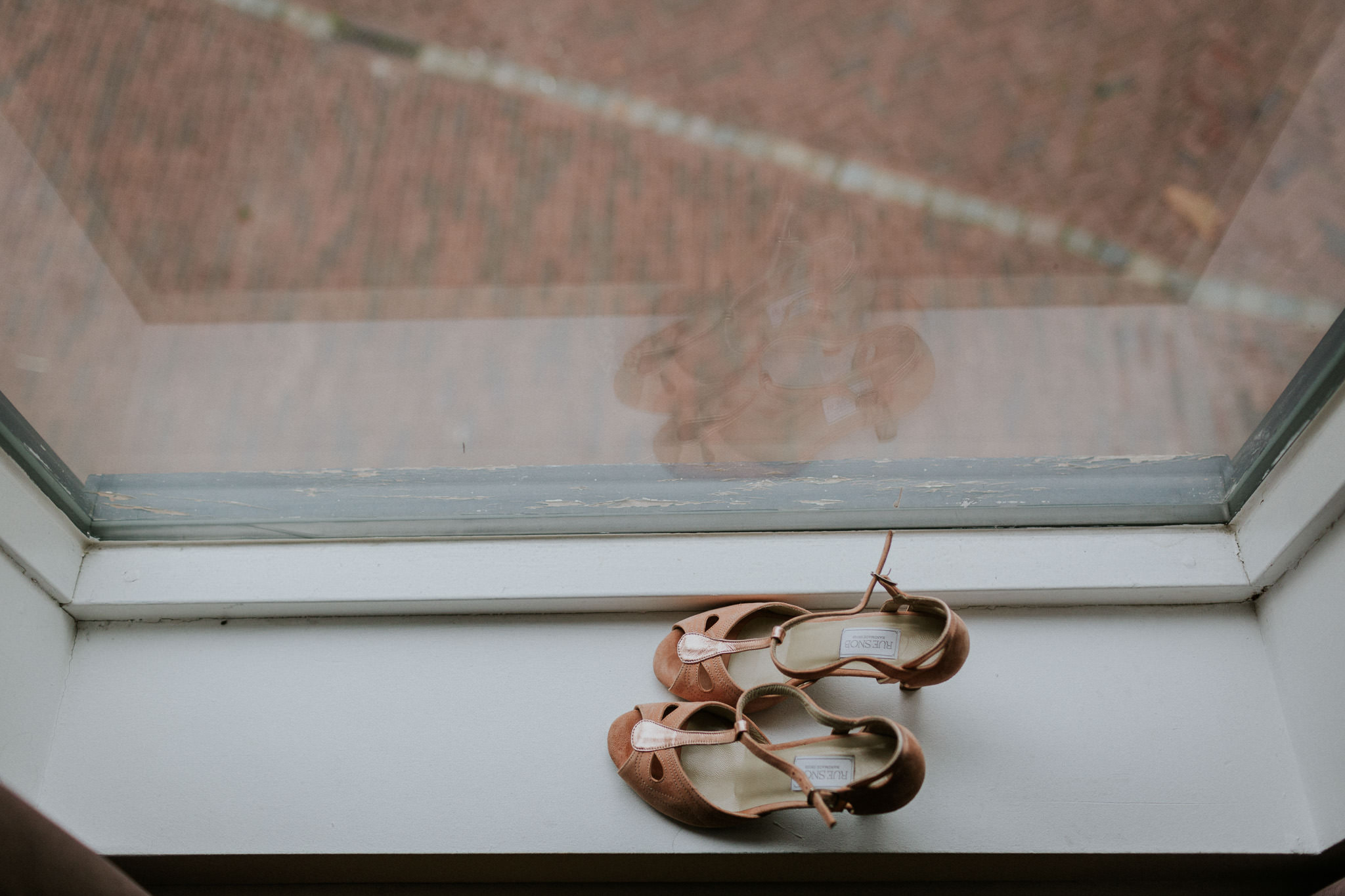 wedding shoes on a window sill