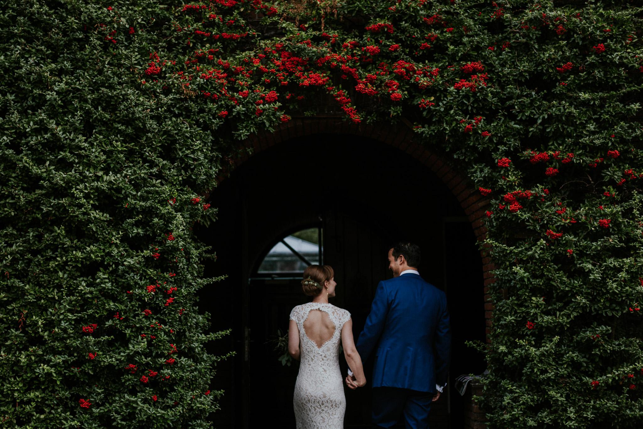 bride and groom walking through Leiden
