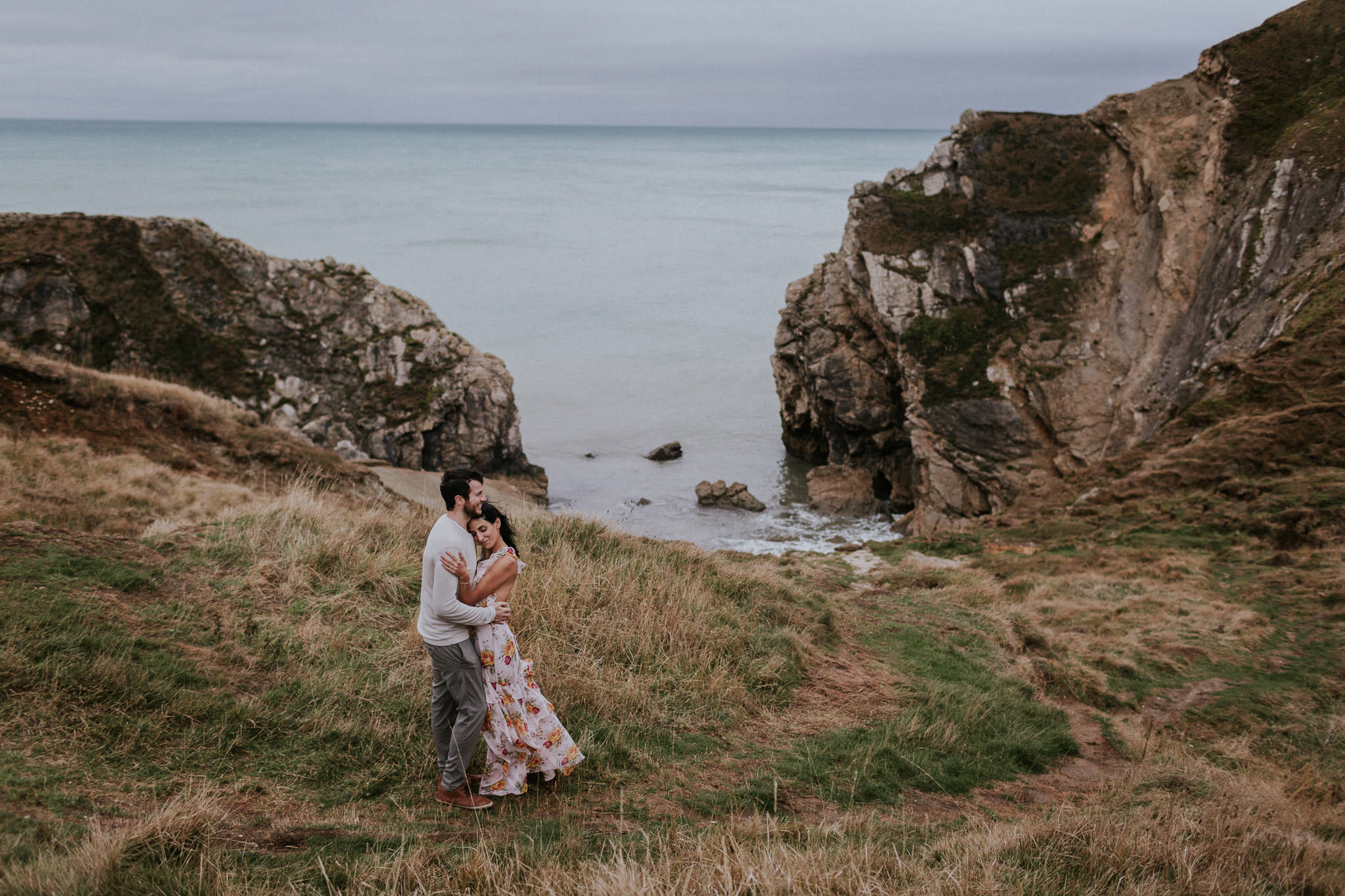 Couple embracing along the coast in Lulworth Cove