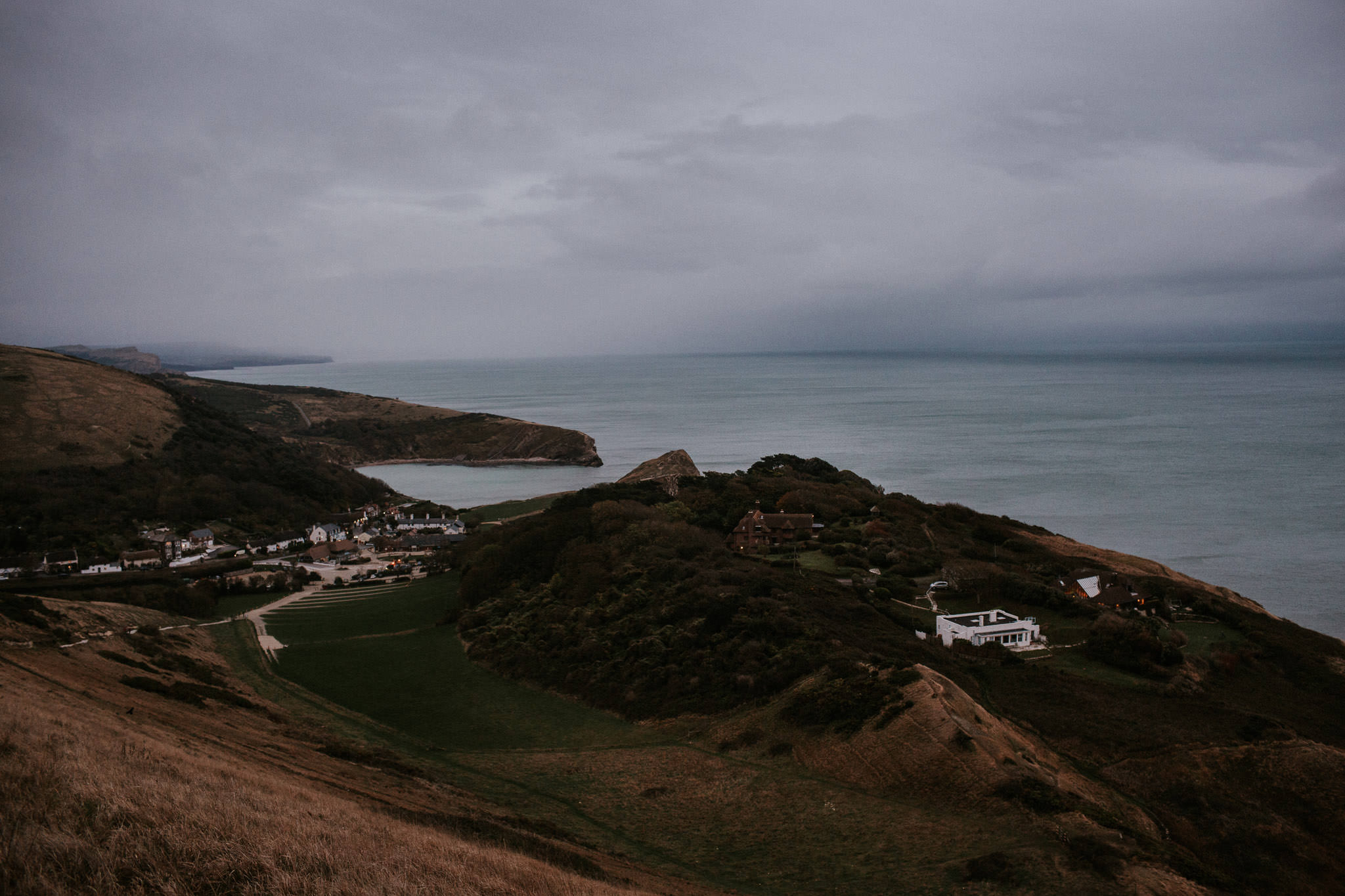A view over Lulworth Cove on an overcast evening