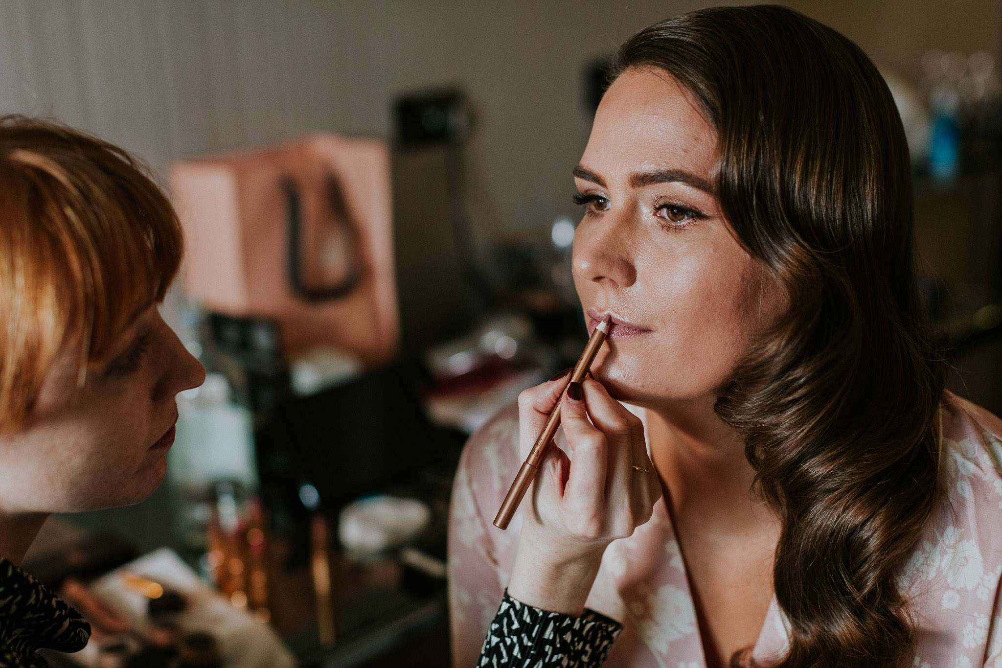 bride having her make up done for Islington Town Hall wedding