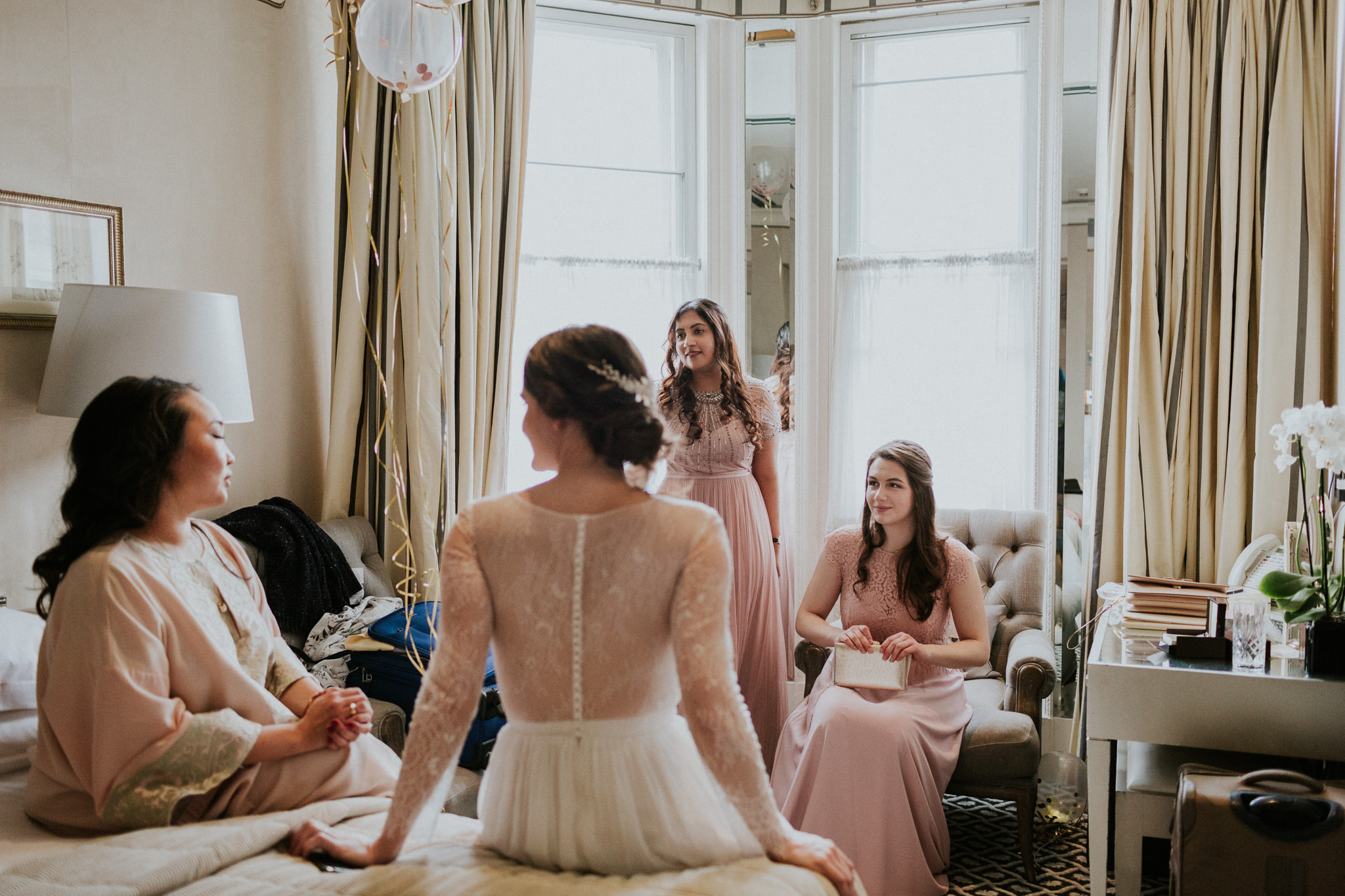 Bride getting ready for the wedding with her bridesmaids