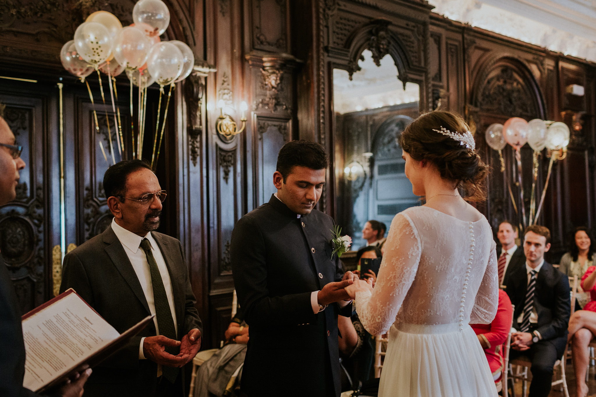 Bride and groom exchanging rings at Dartmouth House
