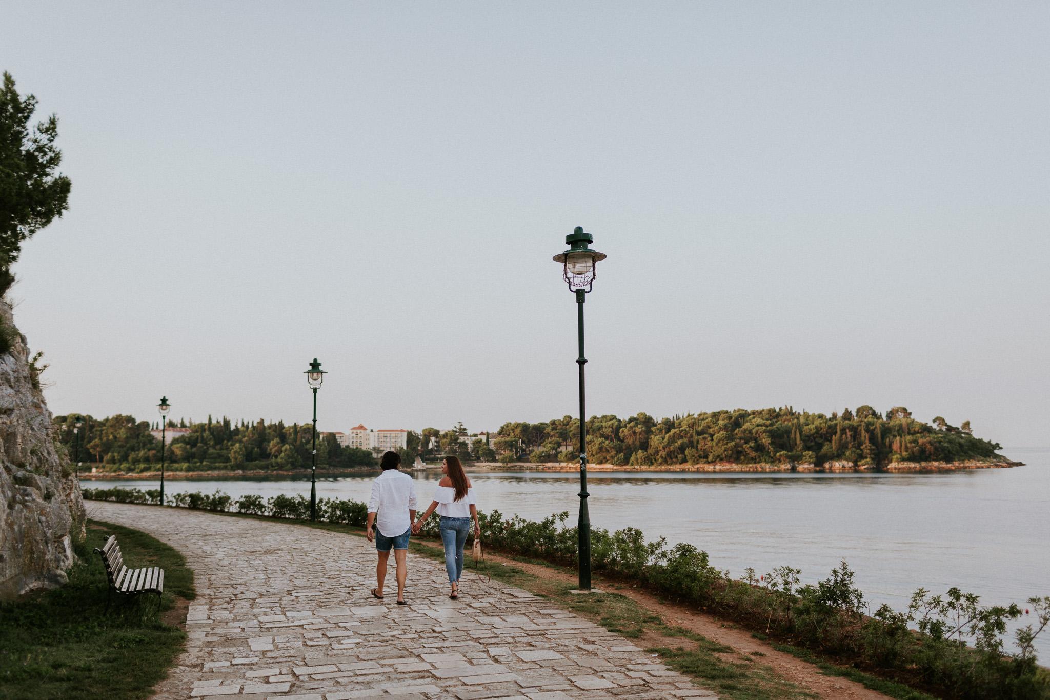 Couple walking in Rovinj, Croatia