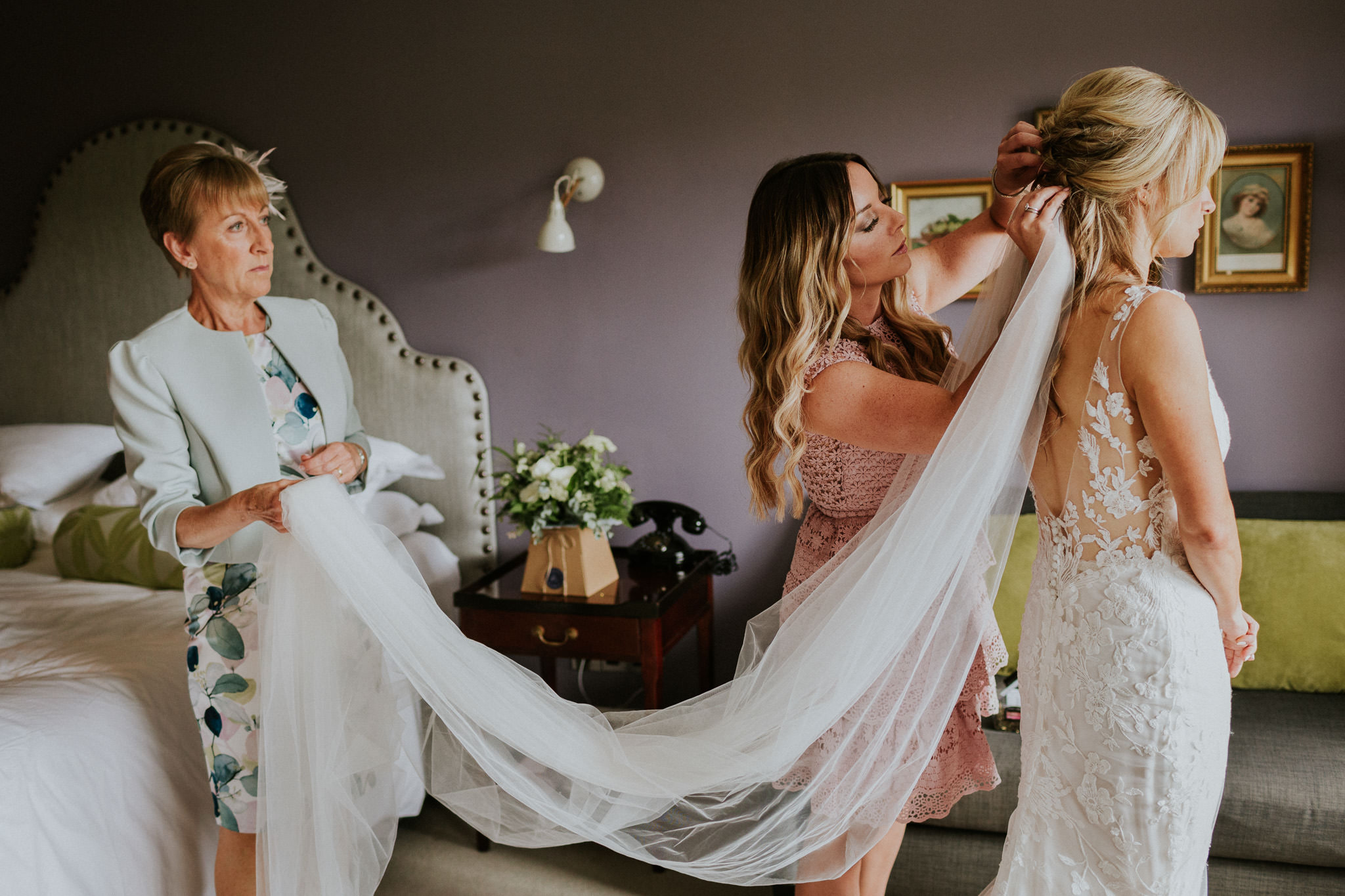 Bride having her vail put on for her Dorset wedding