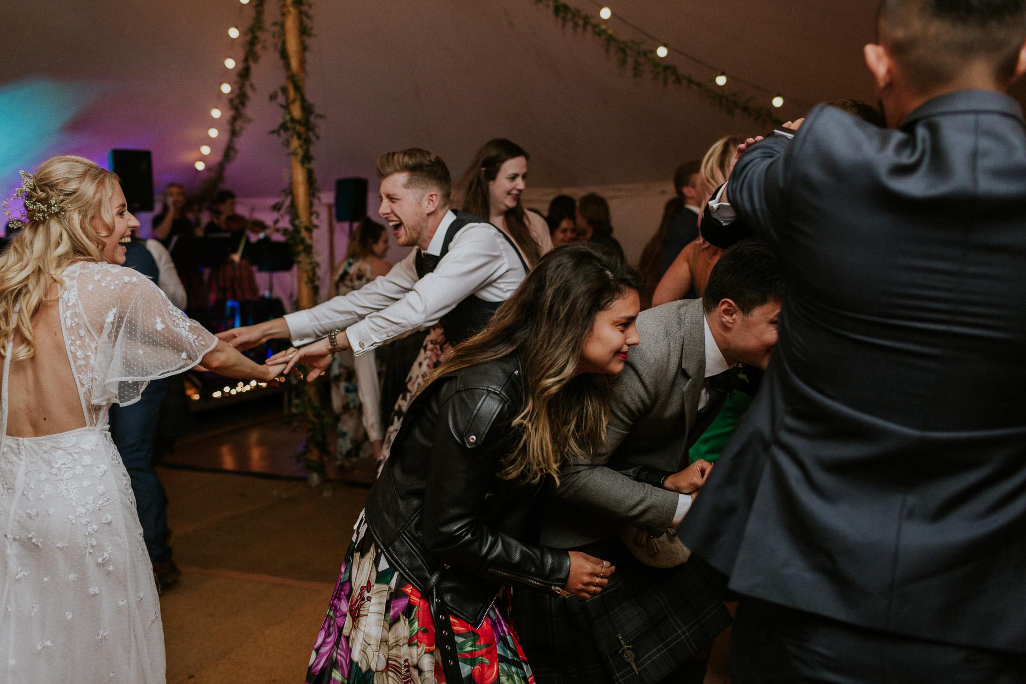 Ceilidh dancing at Highden estate wedding
